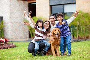 family with dog in yard